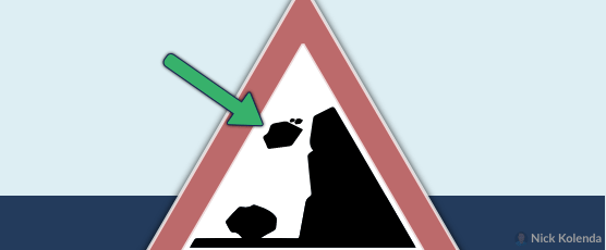 Warning sign with rock falling