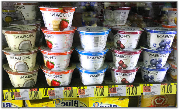 Choosing yogurt from store shelf